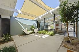 concrete patio. The Sun-filled Atrium Has Been Tastefully Landscaped And Overlooks The  Living Room Area. Concrete Patio