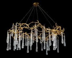brass and glass teardrop eight light chandelier