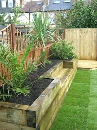 flower bed wall sleeper beds against wall google search flower bed retaining wall wood