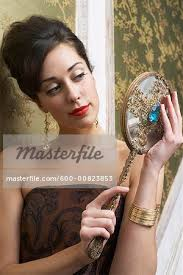 woman holding mirror.  Woman Portrait Of Woman Holding Mirror  Stock Photo With B