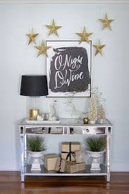 entry table decorations. 20 Chic Holiday Decorating Ideas With A Black, Gold, And White . Entry Table Decorations C