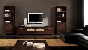 Modern Ethnic Living Room With Small TV Stand And Two Storage Wooden Floor Black Sofa Lcd Tv Image