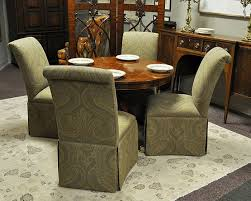 4 upholstered dining room chairs with casters and round table on upholstered dining room