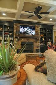 living room built in cabinets stone fireplace centered tv