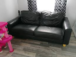 3 seater black leather sofa in