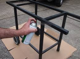 grill frame being painted