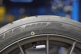 known to the tyre industry as balance dots the dots are there to
