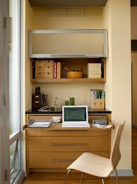 mid century remodel midcentury home office photo in seattle with a built in desk black home office laptop desk