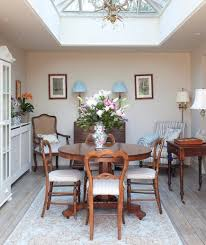 make your formal dining room feel more cal by adding extra seating to the side that can be removed when you expand your table and host a more traditional