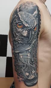 сова и часы Cover Up мужская тату на руке фото татуировок