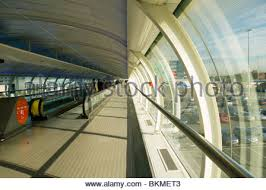 airport walking conveyor belt. the skybridge or skyway at manchester airport, manchester, england, uk - stock photo airport walking conveyor belt