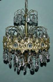 hollywood regency chandelier sold by on table lamp