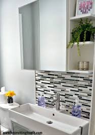 remodelaholic modern bathroom update ikea mirror with storage an inviting home on remodelaholic