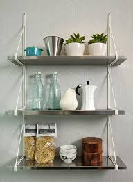 kitchen three rectangle stainless steel wall mounted shelves with white rope on grey wall