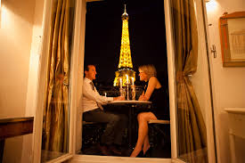 dining with eiffel tower view. paris apartment balcony with eiffel tower view dining i