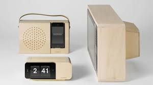 these retrotastic wooden alarm clocks were built to hug your iphone