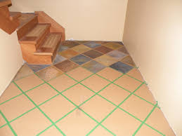 painted basement floor. hand painted faux slate tile floor basement