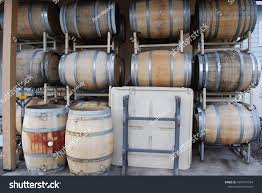oak barrels stacked top. Oak Barrels Stacked Top. On Racks Three High With Wine Making Equipment Top M