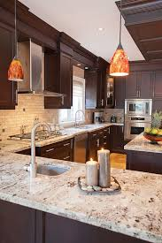 Dark Kitchen Cabinets With Light Granite Classy Giallo Ornamental Granite Countertops Add Elegance In The Kitchen