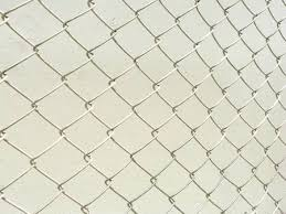 chain link fence texture. Perspective Of Wire Mesh Fence. Repeating Chain Link Fence White Metal  Or Texture