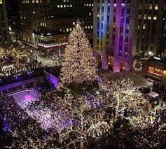 03 Dec 2003 --- The Rockefeller Center Christmas tree stands lit in front of