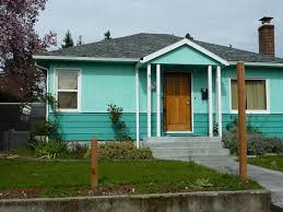 lovely blue exterior house paint ideas for one story house with oak door and wide glass