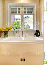 Kitchen Sink Window Kitchen Sink And White Cabinet With Window Stock Images Image
