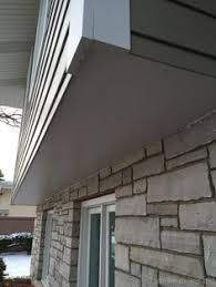 stone veneer on lower part of home brick siding44