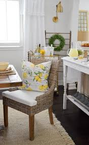 i can t get enough of these woven dining chairs from homegoods a total steal with washable chair pad covers too and the lemon pillows are so zingy