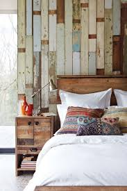 rustic elegant bedroom designs. Exellent Designs An Accent Wall Covered With Rough Wood Planks That Show Their Paining  History Is A Perfect On Rustic Elegant Bedroom Designs U