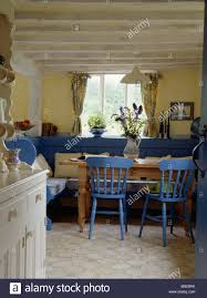 Painted Blue Chairs And Settles In Yellow Cottage Kitchen Dining - Dining room chairs blue