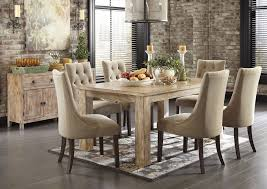 mestler washed brown rectangular dining table w 6 light brown upholstered side chairs signature