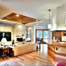 Open Concept Living Area & Kitchen Boast Stunning Wood Accents