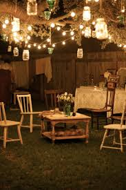 garden party lighting ideas. Garden Party At Night; Lanterns Hang From Tree Branches, And Rustic Furniture With Flowers Lighting Ideas N