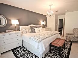 amazing classic chandelier above white bed and wide bedside dressers inside small master bedroom ideas by