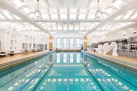 Indoor pool with slide Do It Yourself Junior Olympic Pool At Chicagos Historic Intercontinental Hotel Best Indoor Hotel Pools Travel Mamas 10 Best Indoor Hotel Pools For Kids Hotels With Indoor Pools