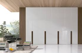 contemporary wardrobe wooden lacquered wood sliding door chic by fernando salas and jordi dedeu