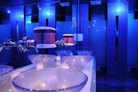 bathroom lighting melbourne. a stylish restroom with blue lighting and bowl shaped sinks mirror reflects the bathroom stalls melbourne i