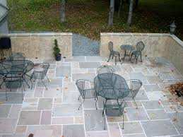 modern grey floor tiles of the stone patio design that can add the beauty inside with glasses table make it seems nice design inside the patio with yellow