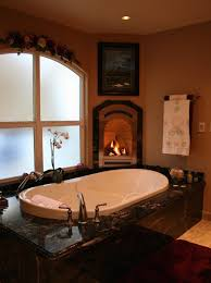 view in gallery a luxurious tub with a small nearby fireplace