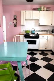 The pink kitchen wall, the blue table, the lime green thing on the stove