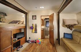 what we love the wildwood hertiage glen 356qb fifth wheel has one of the most spacious bunkhouse with 2 slides and it s own bathroom