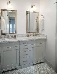 gray bathroom with gray penny tile floor