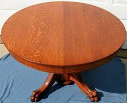 antique victorian round solid tiger oak dining table with pedestal base and lion
