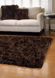 brown faux sheepskin rug plus cozy sofa and side table for living room decoration ideas