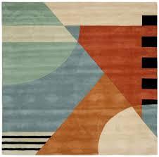 orange and turquoise area rug