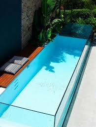 Decoration Of Above Ground Fiberglass Swimming Pool With Stones