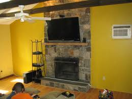 canaan ct tv install on natural stone above fireplace with surround sound