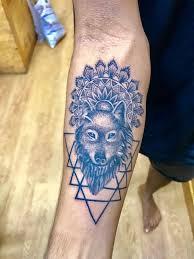 Wolf Tattoo With Triangle By Sans Tattoo Studio Calangute Bardezgoa