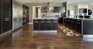 solid red oak hardwood flooring with a dark stain installed in a kitchen